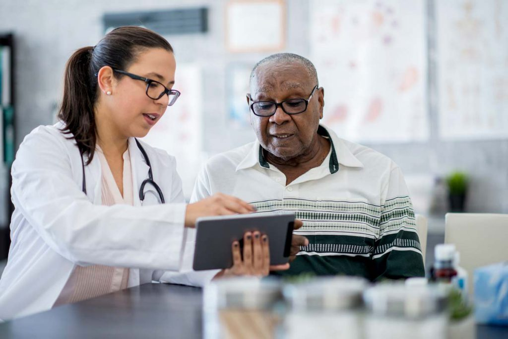 Doctor and Patient reviewing records