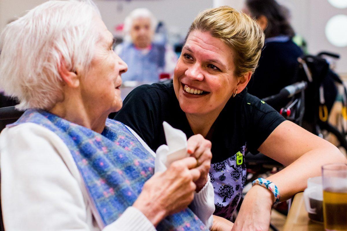 Nurse and Senior enjoying a chat
